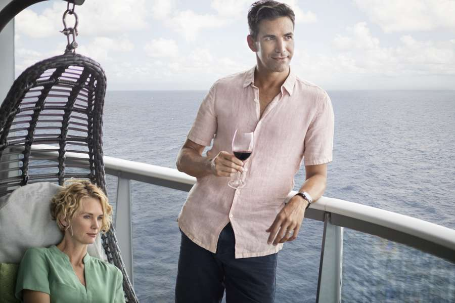 Celebrity Flora posing on deck with wine